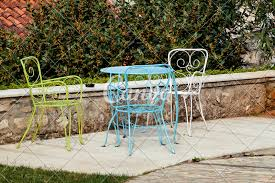 Chairs And A Table In Garden. Colorful Steel Chairs And A ... Stunning White Metal Garden Table And Chairs Fniture Daisy Coffee Set Of 3 Isotop Outdoor Top Cement Comfort Design The 275 Round Alinum Set4 Black Rattan Foldable Leisure Chair Waterproof Cover Rectangular Shelter Cast Iron Table Chair 3d Model 26 Fbx 3ds Max Old Vintage Bistro Table2 Chairs W Armrests Outdoor Sjlland Dark Grey Frsnduvholmen China Patio Ding Dinner With Folding Camping Alinium Alloy Pnic Best Ideas Bathroom