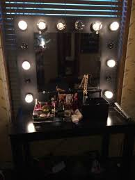 light bulb makeup vanity mirror with bulbs around it in for