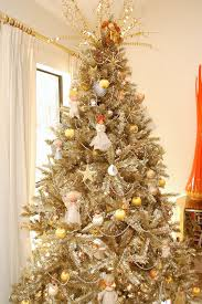 Gold Tinsel Tree Decorated With Vintage Angels
