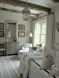 Neutral Bedroom With Rustic Beams And A Whisper Of Blue By