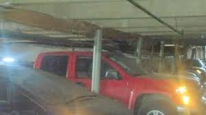 Roof Collapses Crushes Vehicles In Apartment plex Parking