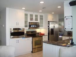 White Kitchen Design Ideas 2014 by Decorating Awesome White Kitchen Cabinets With Slate Appliances