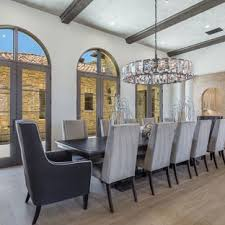Example Of A Tuscan Medium Tone Wood Floor And Brown Dining Room Design In San