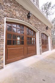 Stone and craftsman style garage doors …