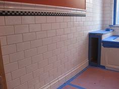 white subway tile baseboard made with quarter bathroom