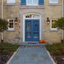country lanterns provide decorative front entry wall