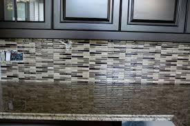 black and grey glass tile backsplash