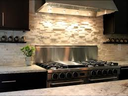 Kitchen Backsplash Ideas With Dark Wood Cabinets by Stunning Cobblestone Backsplash With Lighting Above Stove Also