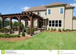Backyard With Pergola Stock Photo. Image Of Trellis, Home - 21425410 Backyards Backyard Arbors Designs Arbor Design Ideas Pictures On Pergola Amazing Garden Stately Kitsch 1 Pergola With Diy Design Fabulous Build Your Own Pagoda Interior Ideas Faedaworkscom Backyard Workhappyus Best 25 Patio Roof Pinterest Simple Quality Wooden Swing Seat And Yard Wooden Marvelous Outdoor 41 Incredibly Beautiful Pergolas