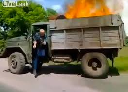 VIDEO: Dump Truck Driver Unaware He's Hauling A Raging Fire