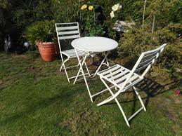 Two White Folding Garden Chairs And Matching Table | In ... Set Of Four Stacking Garden Chairs And Matching White Folding Table In Cambridge Cambridgeshire Gumtree Modern Wooden Folding Director Or Garden Chair On A Background 7 Position Adjustable Back Outdoor Fniture Foldable Rattan Chairs With Foot Rest Buy White Canvas Rows Lawn Botanic Stock Close Up Slatted Wooden Chair Intertional Caravan Royal Fiji Acacia High Bluewhite Camping Wedding Rental Sky Party Rentals Vidaxl 2x Hdpe Balcony Seat 225