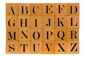 Antique Wood Block Alphabet Letters Isolated Stock Image