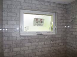 Beveled Tile Inside Corners by Marble Subway Tile Tub Shower Area With A Window Youtube