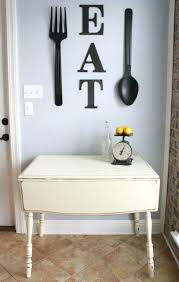 Decorating A Kitchen Wall Eat Letters And Oversized Black Utensils To Decorate Inexpensive Ideas