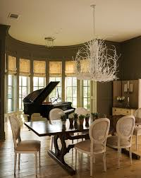 Silhouetted Against A Demilune Bay Window Glossy Black Piano Provides Dramatic Focal Point For Dining Room Painted Earthy Green