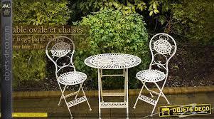 table ovale et chaises en fer forgé