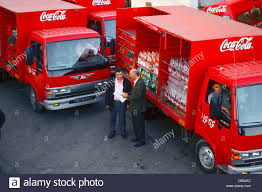 Truck Driver With Coca-Cola Truck Delivering Soft Drinks, Jordan ... Cacola Other Companies Move To Hybrid Trucks Environmental 4k Coca Cola Delivery Truck Highway Stock Video Footage Videoblocks The Holidays Are Coming As The Truck Hits Road Israels Attacks On Gaza Leading Boycotts Quartz Truck Trailer Transport Express Freight Logistic Diesel Mack Life Reefer Trailer For Ats American Simulator Mod Ertl 1997 Intertional 4900 I Painted Th Flickr In Mexico Trucks Pinterest How Make A With Dc Motor Awesome Amazing Diy Arrives At Trafford Centre Manchester Evening News Christmas Stop Smithfield Square