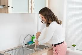 Garbage Disposal Backing Up Into Both Sinks by Clearing A Clogged Kitchen Sink Drain Thriftyfun
