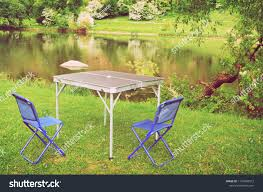 Blue Folding Camping Chairs Metal Table Stock Photo (Edit ... Fold Up Camping Table And Seats Lennov 4ft 12m Folding Rectangular Outdoor Pnic Super Tough With 4 Chairs 120 X 60 70 Cm Blue Metal Stock Photo Edit Camping Table Light Togotbietthuhiduongco Great Camp Chair Foldable Kitchen Portable Grilling Stand Bbq Fniture Op3688 Livzing Multipurpose Adjustable Height High Booster Hot Item Alinum Collapsible Roll Up For Beach Hiking Travel And Fishing Amazoncom Portable Folding Camping Pnic Table Party Outdoor Garden