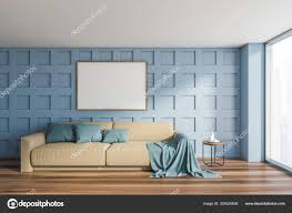 blue living room with beige sofa and mockup poster 324525606