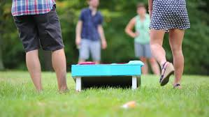 Back Of Legs Man And Woman Playing Bean Bag Toss Game Outdoor