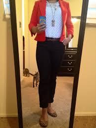 casual black jeans ivory blouse brown belt orange red
