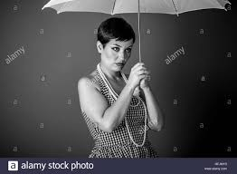 Cheerful Girl Vintage 50s Dress With White Umbrella Over Blue Background
