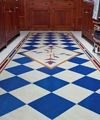 A White Linoleum Kitchen Floor With Craftsman Inspired Runner Made From Tiles An Intricate Border And Stylized Botanical Center Detail