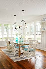 Coastal Home Decor Dining Room With Chandeliers Window Seats Striped Area Rug Design By Sarah Richardson