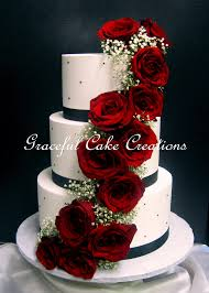 Elegant White Butter Cream Wedding Cake With Black Ribbon