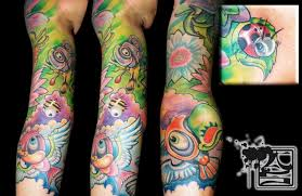 Colorful Nature Inspired Sleeve Tattoo