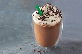 A Creamy Blend Of Rich Mocha Flavored Sauce Chocolaty Chips Milk And Ice Topped With Sweetened Whipped Cream Drizzle