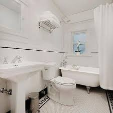 white hex bathroom floor tiles with black key border tiles