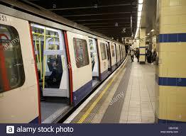 open doors of tube train sitting at station london underground