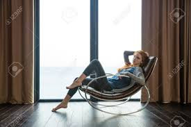 Portrait Of A Beautiful Redhead Woman Sitting On Rocking Chair.. Rocking Chair For Nturing And The Nursery Gary Weeks Coral Coast Norwood Inoutdoor Horizontal Slat Back Product Review Video Fort Lauderdale Airport Has Rocking Chairs To Sit Watch Young Man Sitting On Chair Using Laptop Stock Photo Tips Choosing A Glider Or Lumat Bago Chairs With Inlay Antesala Round Elderly In By Window Reading D2400_140 Art 115 Journals Sad Senior Woman Glasses Vintage Childs Sugar Barrel Album Imgur Gaia Serena Oat Amazoncom Stool Comfortable Cushion