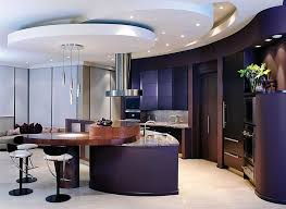 Luxurious Modern Kitchen Awash In Dark Purple And Wood Tones Featuring Marble Topped Island With