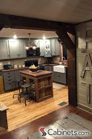 Cute Rustic Kitchen Featuring Deerfield Shaker II Maple Creek Stone Cabinets Pendant Lighting And Industrial Style Stools