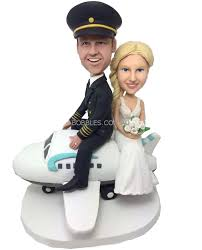 coule on plane wedding cake topper
