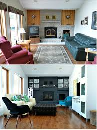 Living Room Makeovers Before And After Pictures by Remodelaholic Dark Gray Painted Fireplace Focal Wall