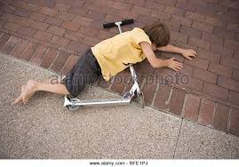 Seven Year Old Boy Falls Off His Scooter And Lands On The Driveway