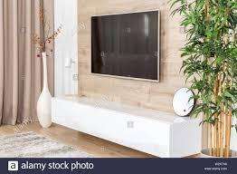 wohnzimmer mit und led tv auf holz wand in modernen