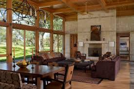 Inspiration For A Large Rustic Open Concept Living Room Remodel In Austin With Stone Fireplace