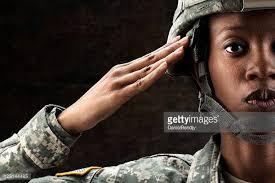 Female African American Soldier Series Against Dark Brown Background