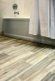 faux wood ceramic tile in the bathroom easy to clean and still