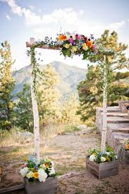A Rustic Wedding Arch With Colorful Wildflower Decorations Built Into Planter Boxes To Brighten Up Any