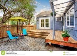 back deck with concrete patio and chairs stock photo