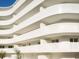 The Undulating Balcony Outlines Confront More Vertically Laid Out Tile Facade Northwest