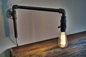 Industrial Lighting Diy How To Make A Modern Swinging Wall Light From Iron Pipe Fittings