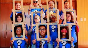 Masters Programs Staff As Characters From Guess Who Board Game