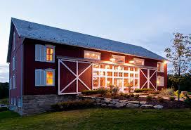 pole barn house plans Exterior Farmhouse with barn barn doors red